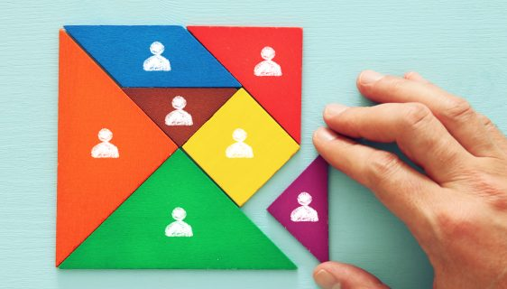 tangram puzzle blocks with people icons ,human resources and management concept.