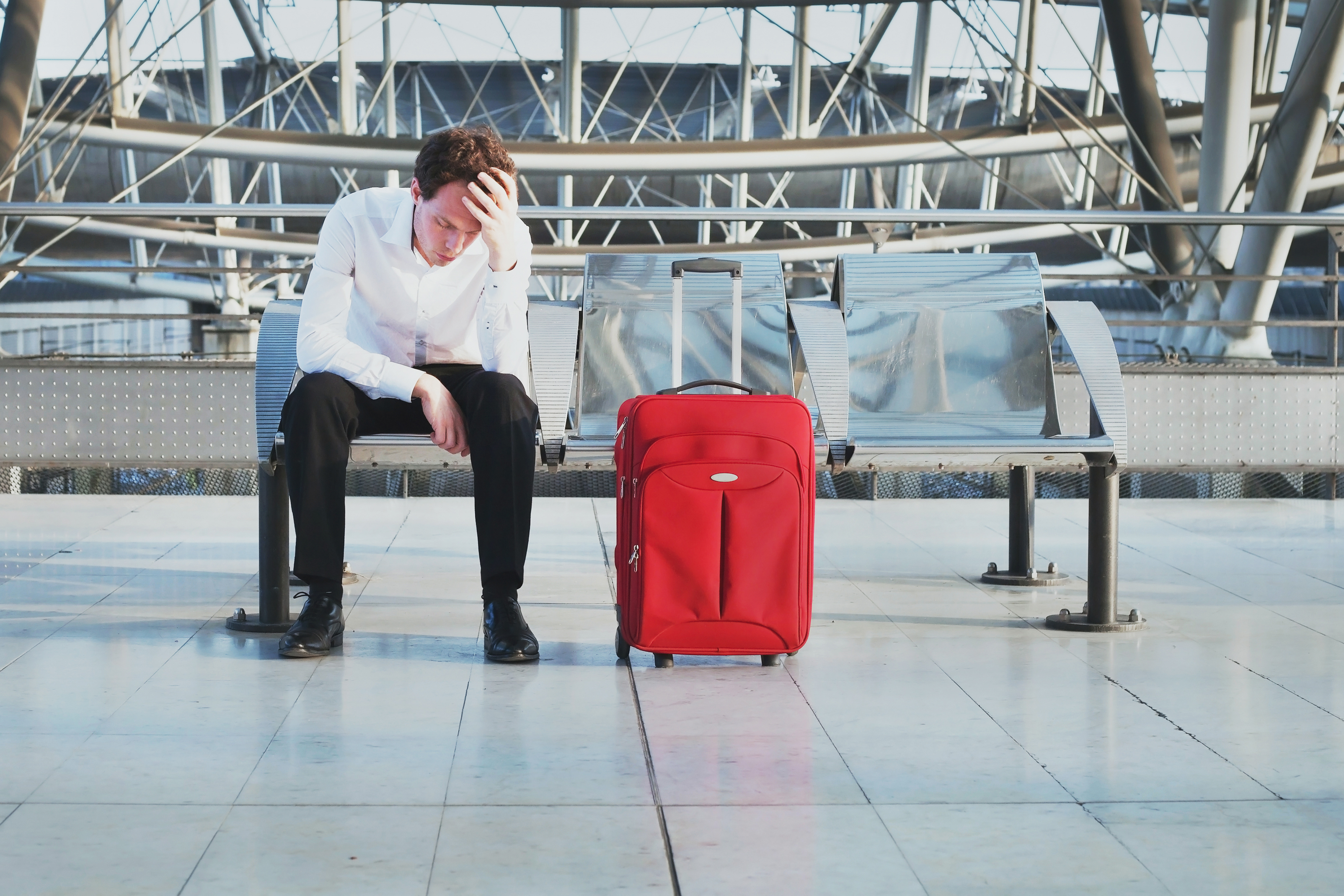 flight delay or problem in the airport, tired desperate passenger waiting in the terminal
