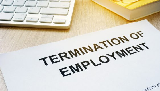 Termination of Employment on an office desk.